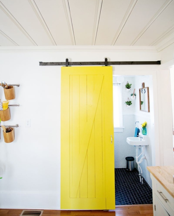 A-sliding-yellow-barn-door-from-A-Beautiful-Mess
